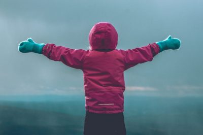 Child with arms outstretched