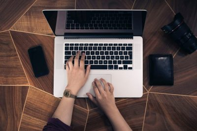 Man checking email on laptop